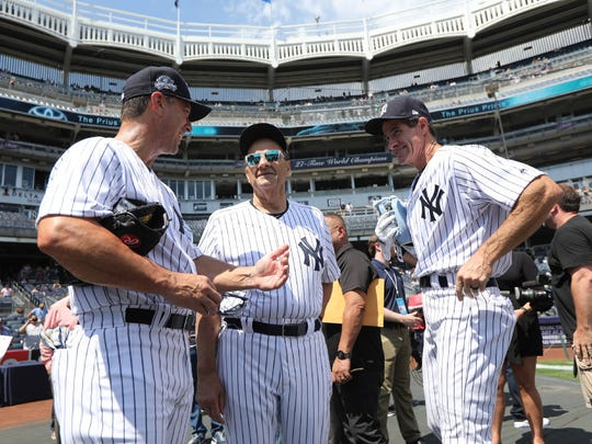 Tino Martinez, Joe Torre and Paul O'Neill attended the Yankees' 71st annual Old-Timers' Day on Sunday at Yankee Stadium.