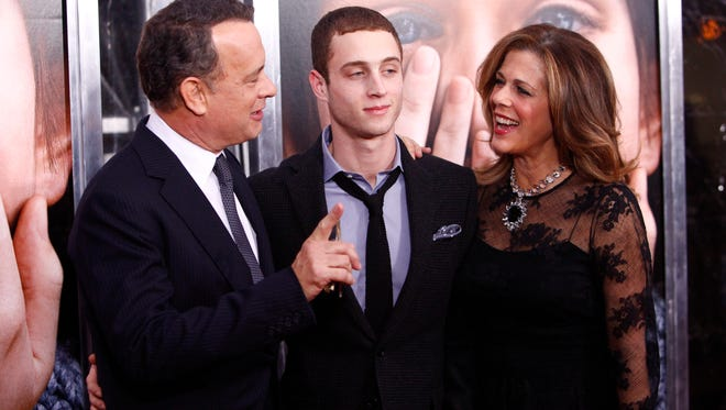 Chester Hanks, center with his parents, Tom Hanks and Rita Wilson in 2011.