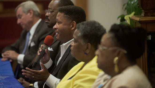Todd Strange, from left, Dan Harris, Artur Davis Buena Browder and Ella Bell take part in the mayoral debate Tuesday at Weeping Willow Baptist Church in Montgomery. Todd Strange, from left, Dan Harris, Artur Davis Buena Browder and Ella Bell take part in the Mayoral Debate at Weeping Willow Baptist Church in Montgomery, Ala., on Tuesday August 18, 2015