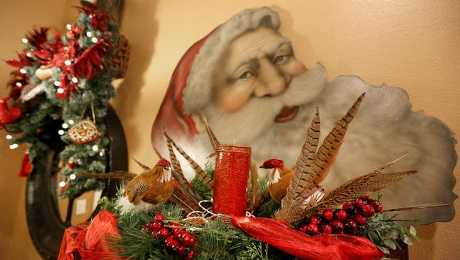 Feathers are a theme in the Christmas decorations inside the home of Tom Anderson and Tass Morrison.