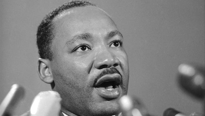 Martin Luther King Jr. talks during a news conference March 24, 1967, in Chicago.