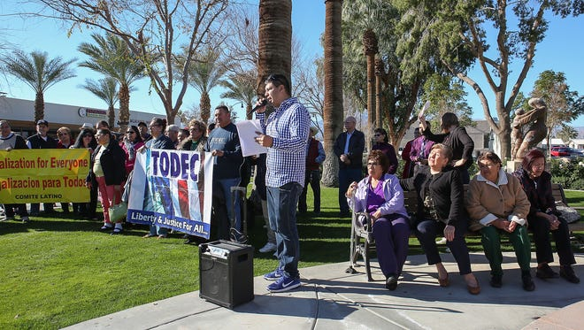 Erick Lemus of the California Partnership speaks Thursday, Jan. 26, 2017, during a rally in Coachella where residents were asked to urge their representatives to strengthen immigrant protections in the wake of President Trump's executive order that could cost sanctuary cities federal funding. Coachella is a sanctuary city.