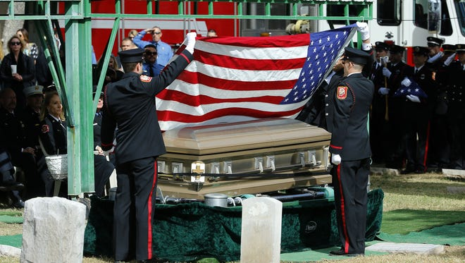 Members of the Phoenix Fire Department pay their respects as they say farewell to Capt. Crystal Rezzonico on Feb. 28, 2017 in Phoenix.