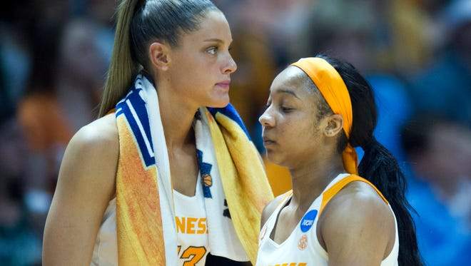 Tennessee's Anastasia Hayes, right, walks past Kortney Dunbar as she returns to the bench in the final moments of the Lady Vols' loss Sunday.