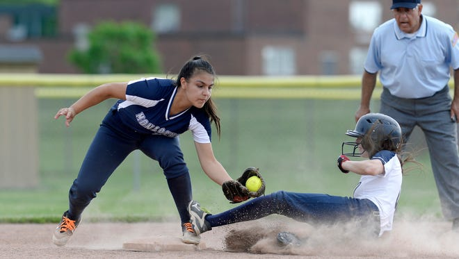 Mercy's Keelan Crowley, left, tags Pittsford Sutherland's Leanna Brown out at second base during the Section V Class A qualifier at Wayne High School, Thursday, May 31, 2018. Mercy advanced to the Class A Wester Regional with a 11-0 win over Pittsford Sutherland.