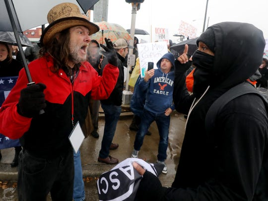 A Trump supporter and Trump protester exchange heated
