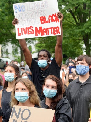 Jahdey Wright, 21, of Colchester is joined by 400 to 500 people on the Colchester Town Green Friday in a Black Lives Matters protest in memory of George Floyd. See stroy, videos and more photos at NorwichBulletin.com