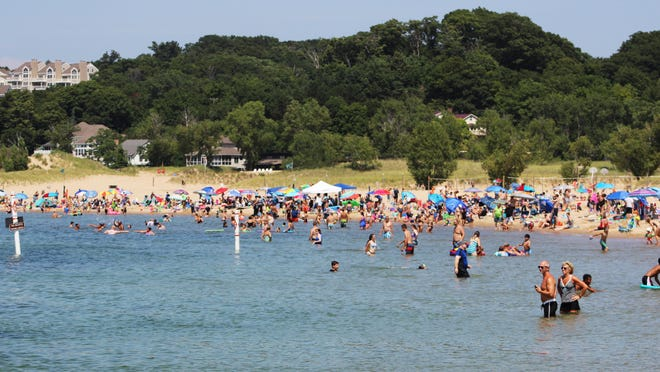 Holland State Park was busy as people took to the beach and to the water during the summer of 2020.