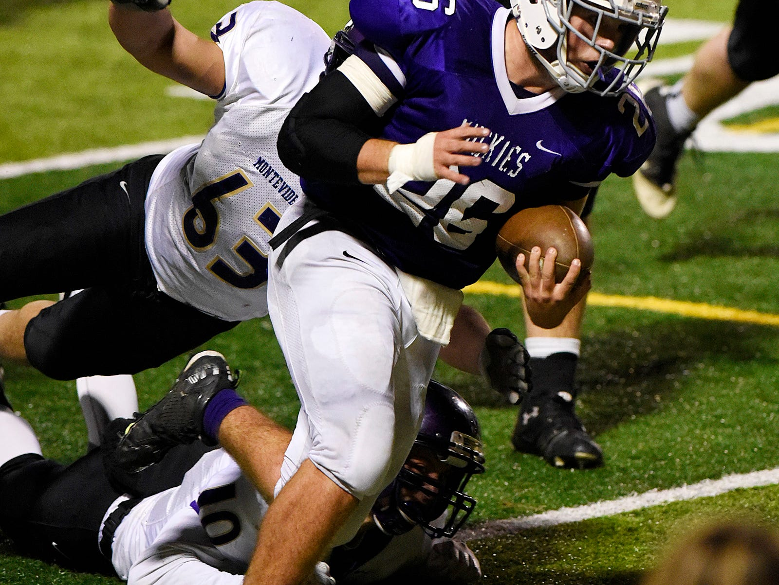 Albany's Will Kleinschnidt takes the ball to the five yard line for the team to score on the next series against Montevideo during the first half Saturday, Oct. 24 at Husky Stadium.
