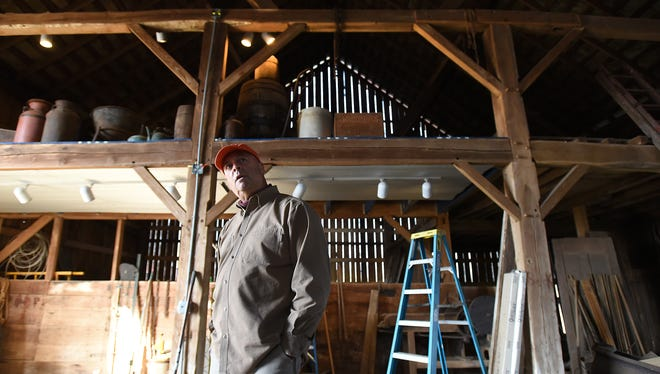 Rick Shriver talks about his plans to transform his 126-year-old barn into a winery recently. Willis Hill Winery will be built in a barn near McConnelsville that has been in Shriver's family for generations.