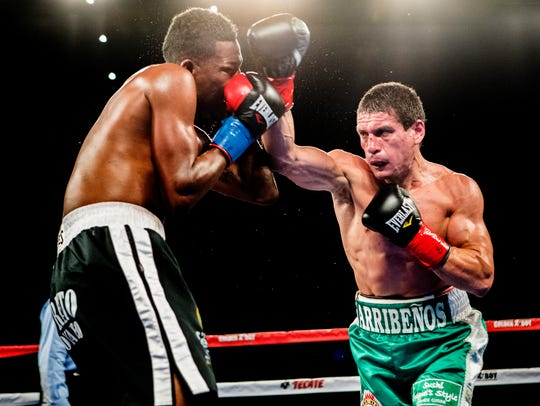 At right, Marcelino Lopez fights Breidis Prescott at