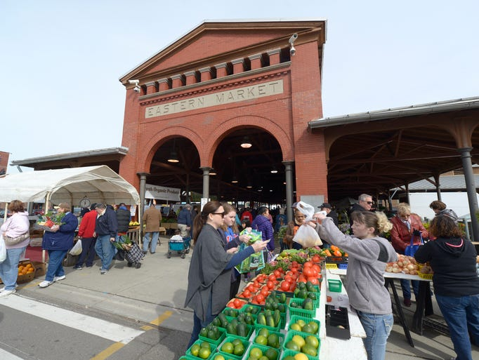 Shoppers buy produce at Eastern Market Saturday, April