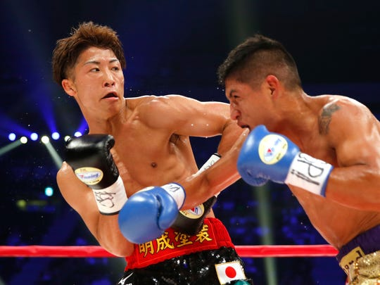 Japanese champion Naoya Inoue, left, dodges a punch from Ricardo Rodriguez of the U.S. in the third round of their WBO super flyweight boxing world title match in Tokyo, Sunday, May 21, 2017. Inoue knocked out Rodriguez in the round. (AP Photo/Toru Takahashi)