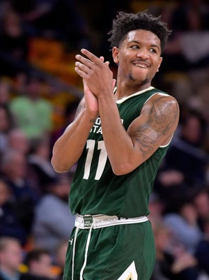 Guard Prentiss Nixon, who led the CSU men's basketball team in scoring this season, claps after a Utah State player missed a free throw following a technical foul against the Rams during a Jan. 10 game in Logan, Utah. Nixon said Friday he will transfer from CSU to play his senior season elsewhere.