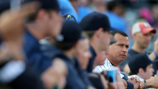 New York Yankees third baseman Alex Rodriguez, right, watches the baseball game from the dugout during a minor league rehab start for the Trenton Thunder against the New Hampshire Fisher Cats on Tuesday, May 24, 2016, in Trenton, N.J.
