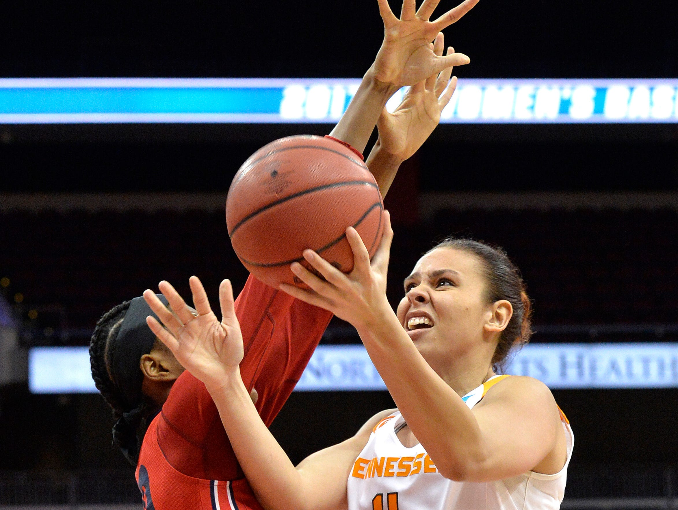 Tennessee's Schaquilla Nunn shoots past Dayton's Saicha Grant-Allen on Saturday in Louisville, Ky.