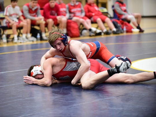 The record for most career wins in Westland John Glenn history goes to senior co-captain Mikey Mars (top), shown from the recent Division 1 team regional.