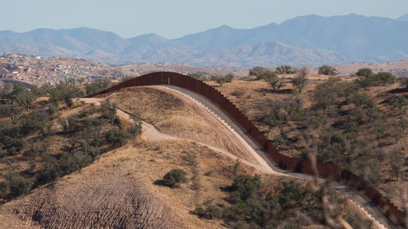 The border fence stretches west of Nogales into the