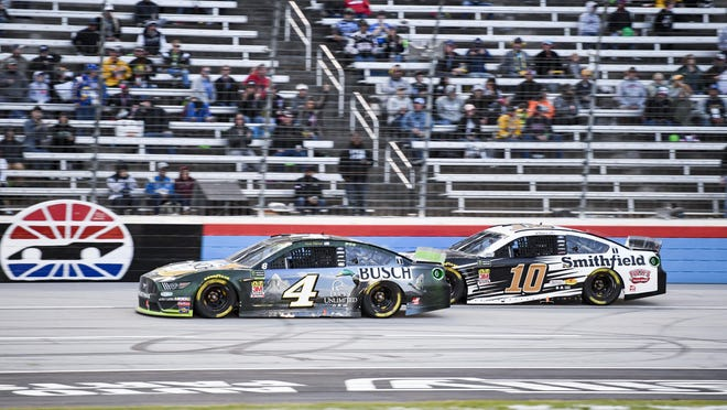 Drivers Kevin Harvick (4) and Aric Almirola (10) battle for position during a NASCAR Cup Series race Nov. 3, 2019 at Texas Motor Speedway in Fort Worth, Texas. The race Sunday at Texas Motor Speedway will be one of the largest gatherings of any kind in the state since the start of the coronavirus pandemic.