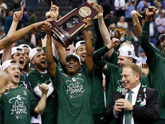 Michigan State players and coach Tom Izzo celebrate