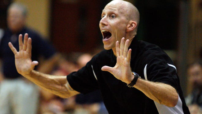 Community School head coach Bill Carufe shouts directions during the fourth quarter as the Community School of Naples boys basketball team faced Clearwater Calvary Christian in the Class 2A regional final on  Feb. 23, 2008. Carufe recently was named the director of basketball operations at Seacrest and will coach the Stingrays boys team.