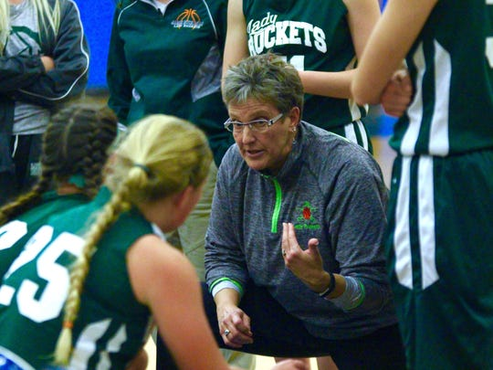 James Buchanan's Jen Lauthers consults her team during a timeout against Waynesboro during the first round of the Franklin County Tip-Off Tournament on Friday, Dec. 9, 2016. The Maidens won, 56-33.