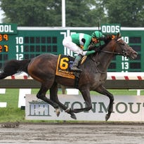 Exaggerator, with Kent Desormeaux riding, wins the $1 million Haskell Invitational horse race at Monmouth Park Sunday