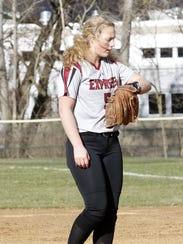 Bella Reese checks her signs for Elmira during a game