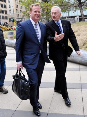 The contract of NFL Commissioner Roger Goodell, left, is under fire by Dallas Cowboys' owner Jerry Jones.