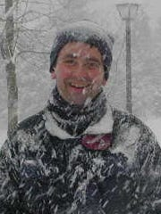 A file photo of Rutgers professor and New Jersey state climatologist David Robinson enjoying the snow in his favorite season.