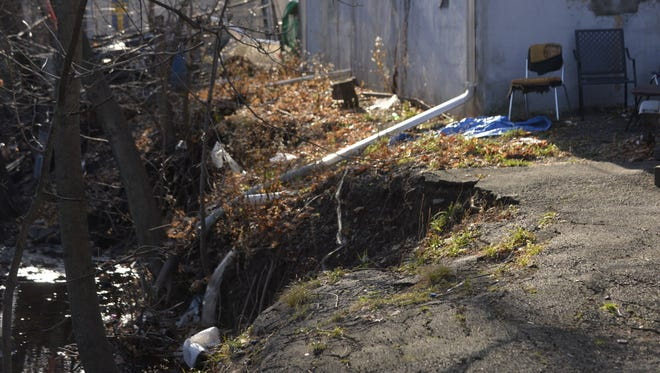 Erosion along a tributary of Overpeck Creek has affected Bergen County Collision on West Forest Avenue in Englewood