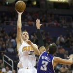 The Suns' Jon Leuer puts up a shot as the Kings' Marco Belinelli defends during the second quarter of the NBA game at Talking Stick Resort Arena in Phoenix on Wednesday, November 4, 2015.