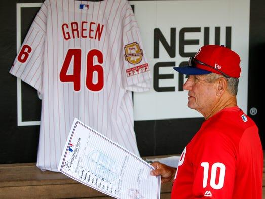 Phillies bench coach Larry Bowa walks past a jersey