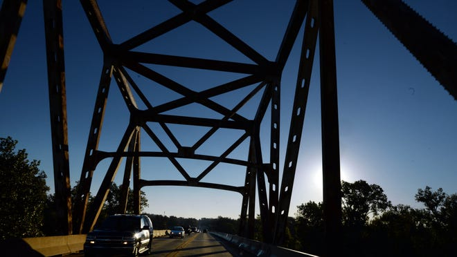Traffic flows on the Jimmie Davis Bridge that is expected to close in early 2015 for about a year for painting and repairs. The bridge was built in 1968.