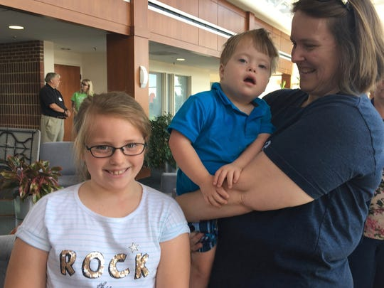 Harper Gibson, 8, of Harrisonburg, said she wants to be an astronaut when she grows up. She stands beside her brother Emmett Gibson, 3, and mom Kathleen Gibson at Women Can Fly on Saturday, July 7, 2018, at Shenandoah Valley Regional Airport in Weyers Cave.