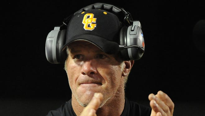Former Green Bay Packers quarterback Brett Favre says he won't coach at Oak Grove High School in Hattiesburg, Miss., this season.