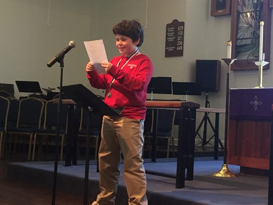 Harrison DeGuire, a Holy Comforter fourth-grader, reads