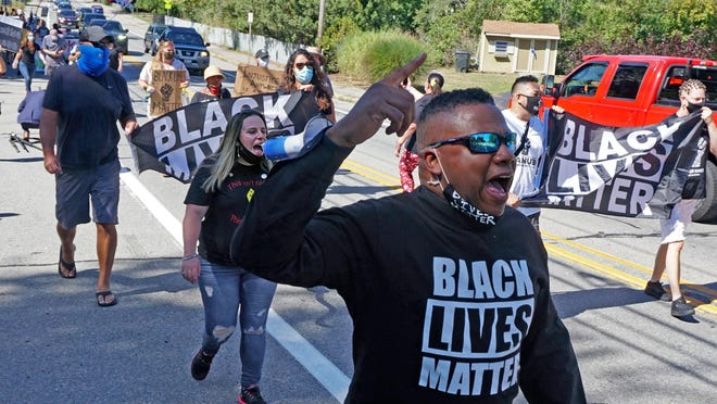 Members of Black Lives Matter and supporters march from Barrington Congregational Church to Town Hall on Saturday during a rally for social justice.