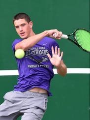 Bloomfield Hills sophomore Tommy Herb warms up before