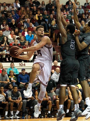 Bellarmine University's Rusty Troutman (5) fights pressure from Lincoln Memorial University's Curtis Webb (5) during the first half of play at Bellarmine University in Louisville, Kentucky.       January 2, 2016