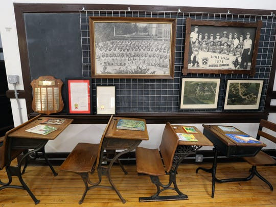 A display of antique school desks at the Sheldon Wolpin