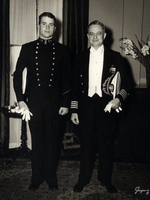 John McCain stands in military dress uniform next to his father, John S. McCain Jr., in this undated file photo. Born the son and grandson of Navy admirals, McCain was destined for a military career.
