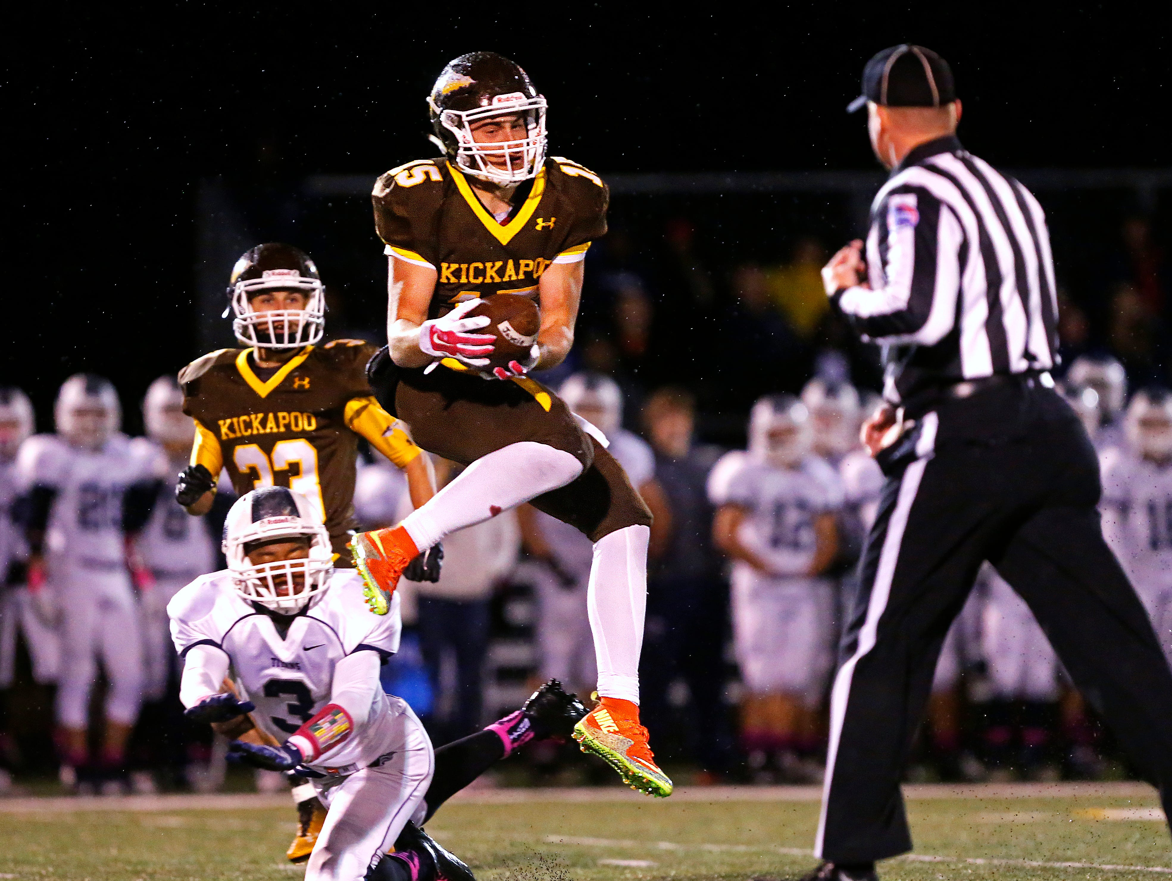 Kickapoo High School safety Mason Pack (15) intercepts a Titans pass during second quarter action of the Chiefs' game against Lee's Summit West High School at Pottenger Stadium in Springfield, Mo. on Oct. 30, 2015. Kickapoo won the game 26-7.
