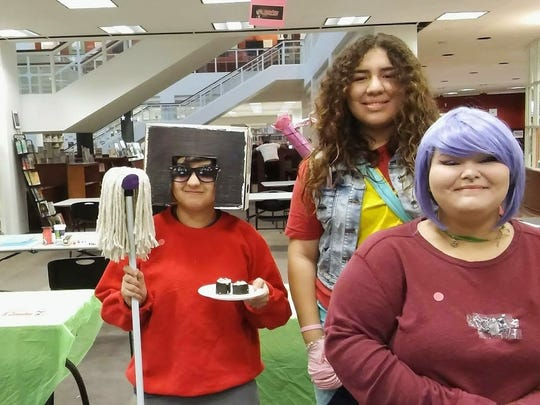 Sierra Dominguez, center, and friends show off their casual cosplay during a manga mixer in November. The upcoming mixer highlights Valentine's Day.