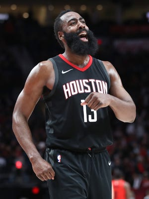 Houston Rockets guard James Harden (13) celebrates a 124-117 win over the Portland Trail Blazers at Moda Center.