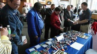 Veterans looking for work stop at the 2009 Recruit Military job fair at Paul Brown Stadium.