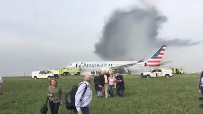 This frame grab from a video handed out via Twitter by user Jose Castillo shows passengers evacuating  American Airlines flight 383, which suffered a malfunction on takeoff at Chicago O'Hare International Airport on Friday, Oct. 28, 2016.