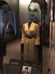 A photo of a dress made and worn by Civil Rights advocate Rosa Parks.