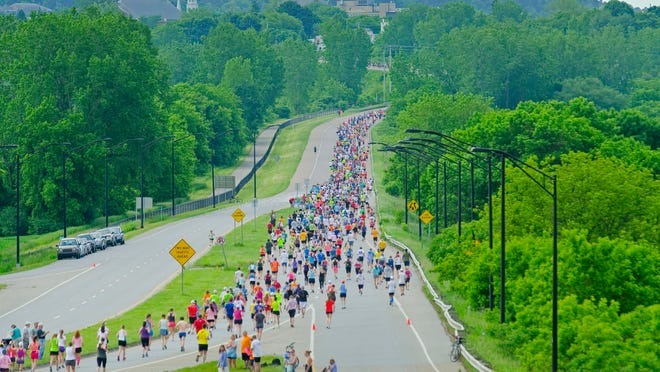 Runners head into downtown after running out the Beltline and back during the Vermont City Marathon in 2012.