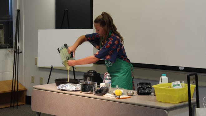 Lizzie Kreider, of Lebanon, demonstrates how to prepare a recipe as part of her state winning foods and nutrition presentation.